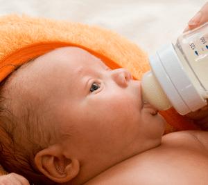 babysitter-feeding-milk-to-baby