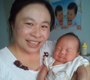 Confinement Nanny with Sleeping Baby - Singapore Confinement Nanny Agency