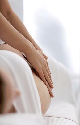 Pregnancy Massage Therapist Massaging Pregnant Woman