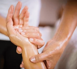Post Natal Massage Therapist Massaging Hands