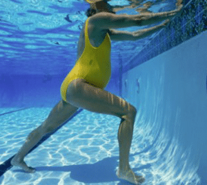 Pregnant Woman Stretching During Prenatal Swimming Lesson