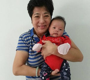 confinement nanny feng with newborn baby